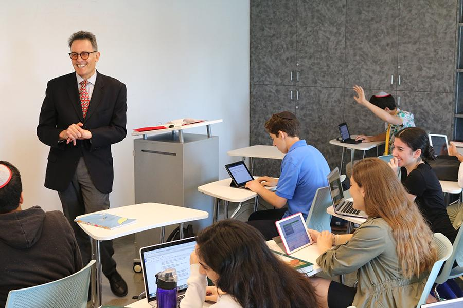 DAPPER: Dr. Yoss taught a ninth-grade class in the Music Room last week.  The Oxford-educated veteran history teacher also teaches American History and Humanities this year.
