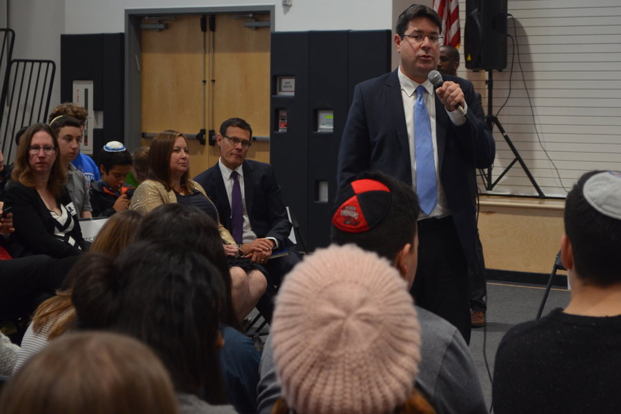 BUSY: Israeli  Minister of Science, Technology and Space,  Ofir Akunis, spoke to an all-school assembly Feb. 8, as Consul General David Siegel looked on.  Minister Akunis was in the U.S. to work on research and space agreements.