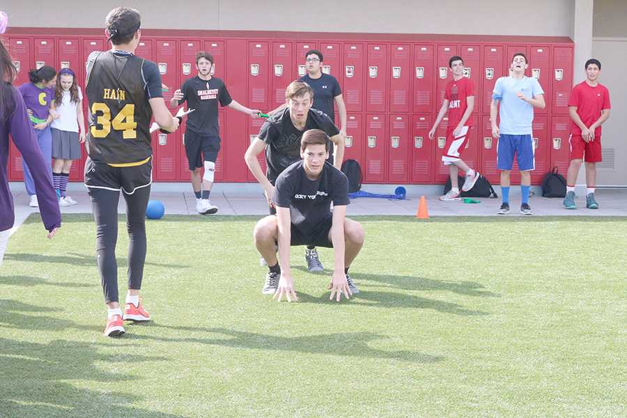 LEAPFROG: Seniors J.J. Helperin and Josh Joffe, cheered on by teammates, help lead the black team to victory in the first-ever Apache Relay.