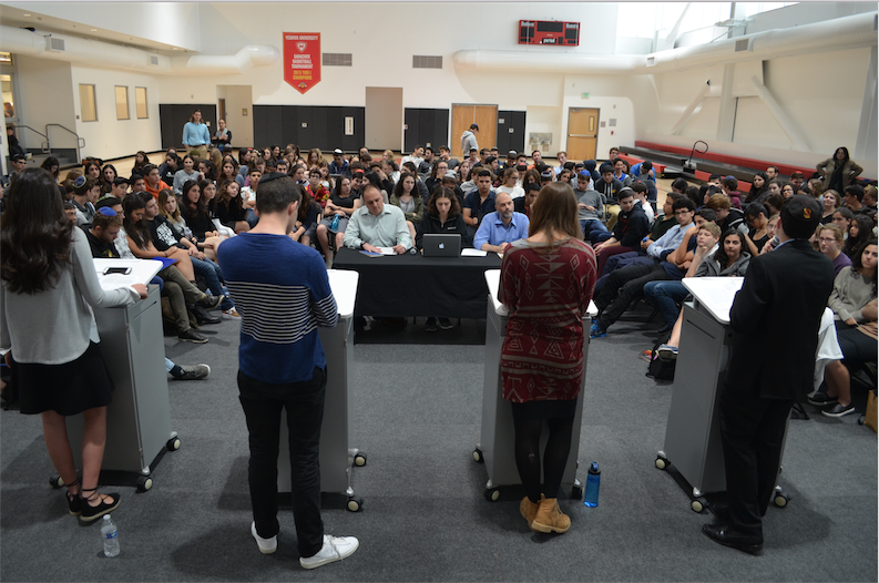 TABLE%3A+From+left%2C+General+Studies+Principal+Mr.+Daniel+Weslow%2C+Hannah+Jannol+of+the+Boiling+Point%2C+and+Dean+of+Students+Mr.+Jason+Feld+posed+questions+to+candidates+for+Agenda+Chair+in+the+gym+May+12.+
