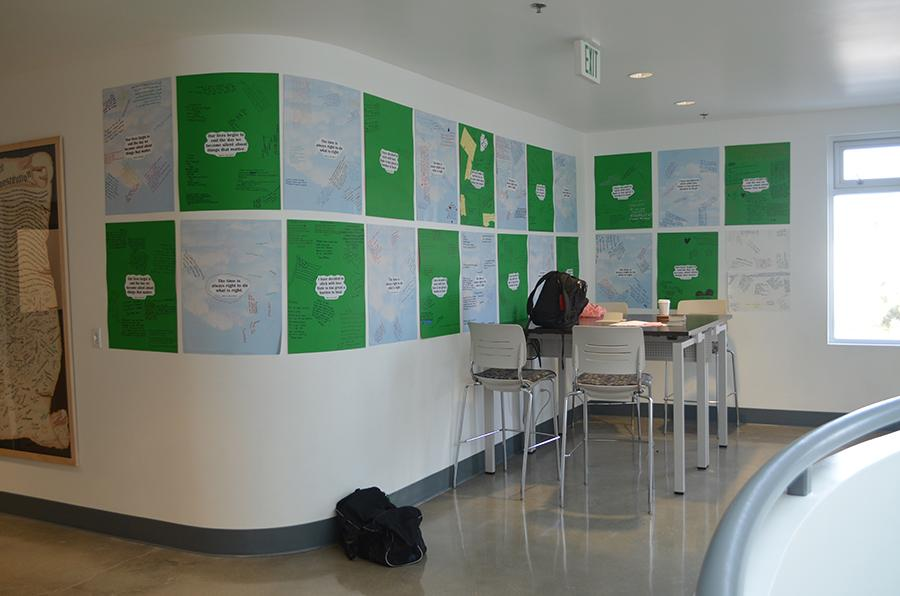 DISPLAY: Poems written by students on poster boards during MLK Day hang on the walls of the second-floor main hallway since that day.