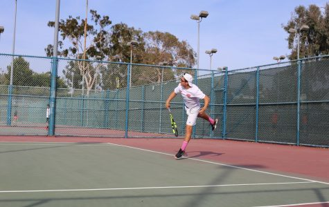 COACH:Junior Nathan Benyowitz, ranked 100 in tennis among 18-year-olds in California, plays a match as head of the Firehawk tennis team.