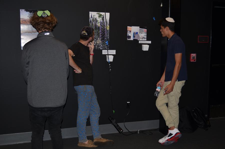 CLICK: Guests stroll through theWildfire Theater admiring student photography. The new club raised approximately $250 for ELEM, an Israeli organization that aids homeless teens.