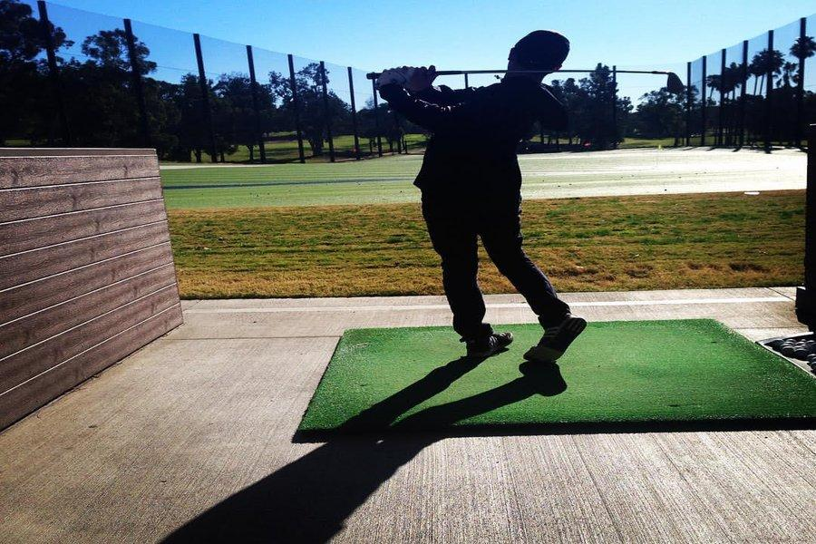DRIVE: Freshman Michael Soussana takes a shot at the driving range where the golf team practices.