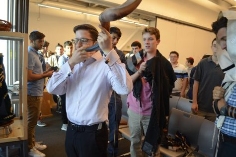 BLAST: Rabbi Block blows the shofar during Hashkama minyan, a reminder to the students about the importance of listening.