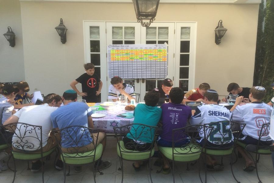 GATHERING: Boys in the Just Community League congregated at Alec and Jordan Fields' house for the Fantasy Football draft Sept. 4. They were encouraged to wear their favorite players' jerseys.