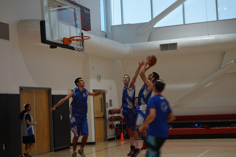 WARMUP: Members of the Elitzur Petach-Tikvah basketball team from Israel practiced in the gym Nov. 9.
