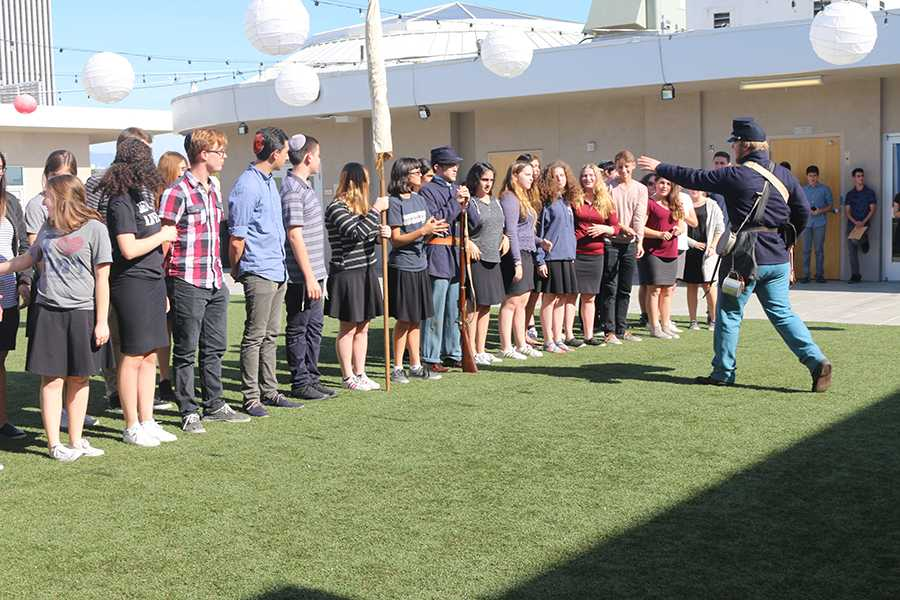 ORDERS: Students from all grades lined up in military formation on the rooftop turf Nov. 9, reenacting roles in a South Carolina regiment during the Civil War. The event was brought to the school by history teacher Dr. Keith Harris.
