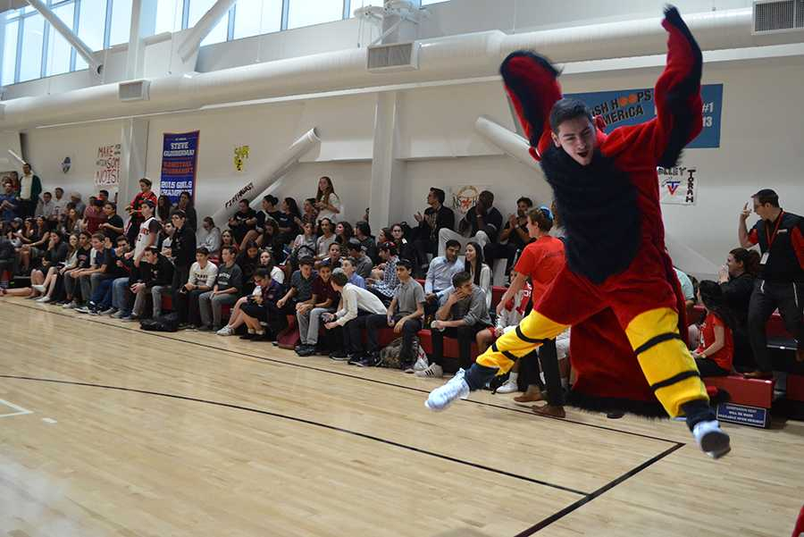 SOAR: Firehawk Mascot Eli Greenberg shows the meaning of ruach (spirit) even without his bird mask. The Glouberman Tournament included seven new teams this year from Los Angeles to Israel to compete in memory of almuni parent Steve Glouberman. See stories on pages 21 and 22.