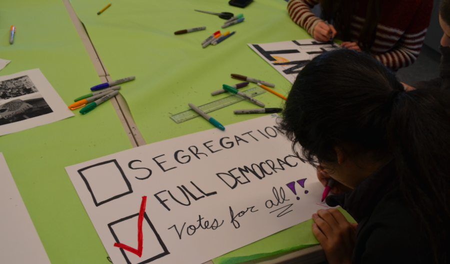IMMERSE: Students made posters reflecting values of the Civil Rights era on Martin Luther King, Jr., Day Jan. 16.
