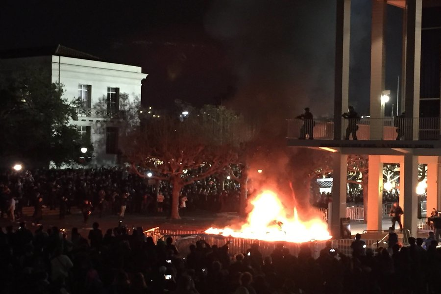 PROTEST: Joined by 150 outsiders, Berkeley students protested Milo Yiannoupoulous by setting fires and destroying property Feb. 1..