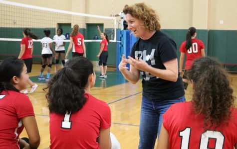 PEP TALK: Volleyball coach Ms. Marla Weiss offers pointers to her players during a game against Ambassador High School in the gym Oct. 17.