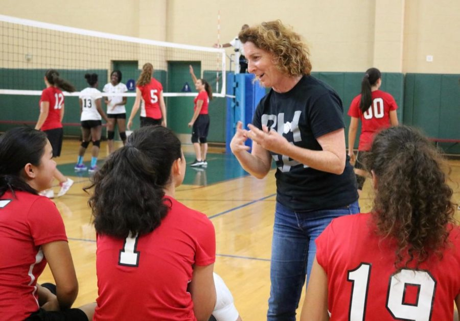 PEP+TALK%3A+Volleyball+coach+Ms.+Marla+Weiss+offers+pointers+to+her+players+during+a+game+against+Ambassador+High+School+in+the+gym+Oct.+17.