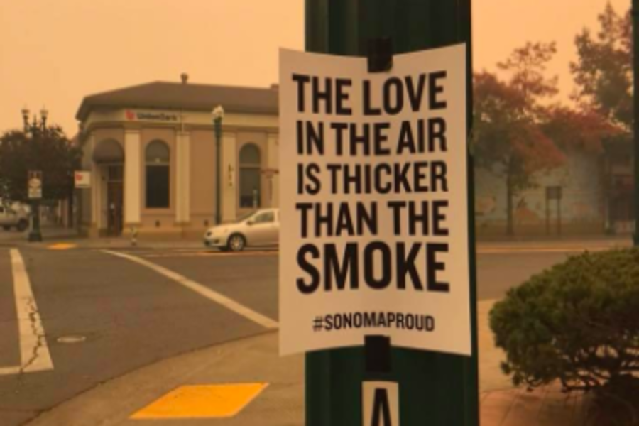 SMOKE: In Santa Rosa, in Northern California, 2,834 homes burned in devastating October fires. Schools were closed for three weeks, students fell behind in their APs, and college plans were changed. Above, a hopeful sign in downtown Santa Rosa.