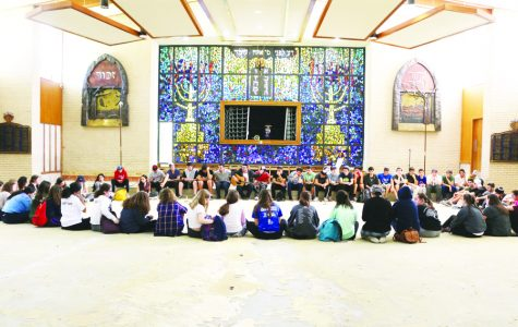 The class of 2019 hears from the rabbi in the gutted sanctuary of United Orthodox Synagogue.