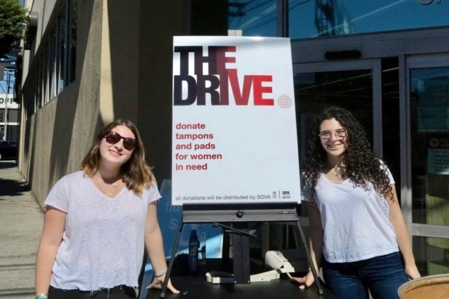 """IMPACT: Senior Sarina Finn, right,  and junior Nomi Willis wanted to """"normalize"""" the need for monthly supplies."""