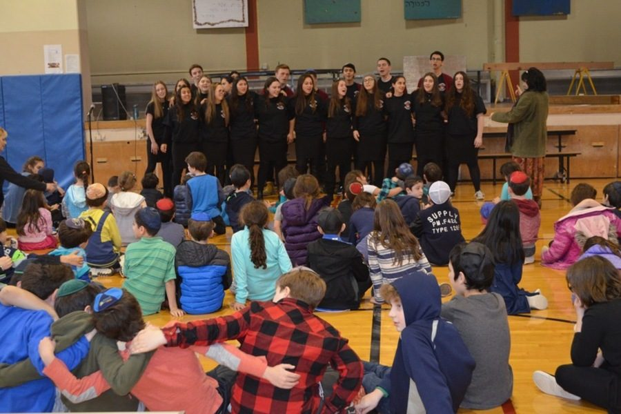 SHARING: Students at Seattle Hebrew Academy heard the Choirhawks' Chanukah songs Dec. 14. The next day the group sang at Northwest Yeshiva High School, where Mr. Jason Feld is head of school.