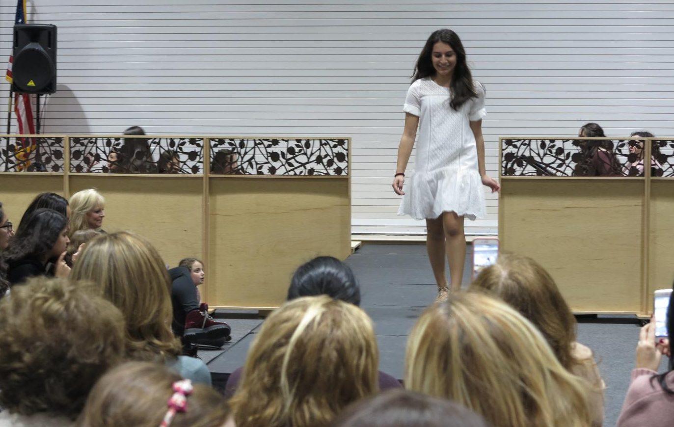 RUNWAY: Freshman Rena Harkham modeled a white dress at the Fashion Clubs third annual
