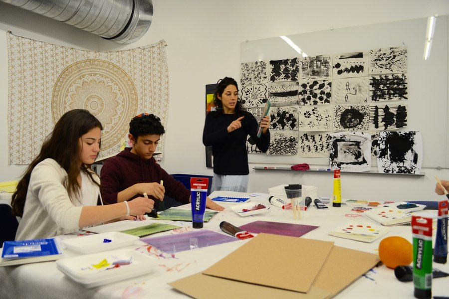 EXPLORE: Mrs. Samantha Garelick, right, explained to Michelle Navi and Yehudah Zadeh in the new art room, B102.