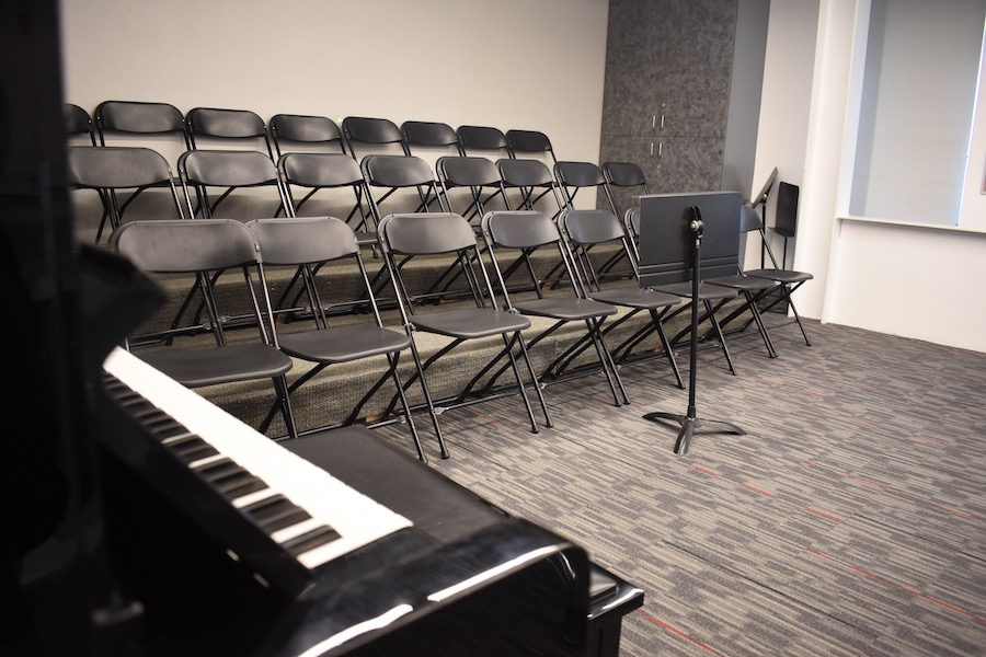 RENOVATION: Risers, a carpet and a new piano were added to the music room over the past year. The choir practices there twice a week, and singers report they can see and hear better.