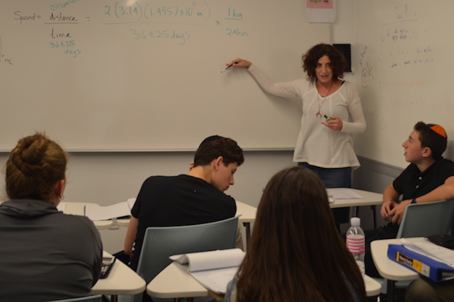 THINK:   Ms. Greenman said she tried to show students how to approach not only math, but life.  Above, she taught 10th-graders in Room 307 this afternoon.