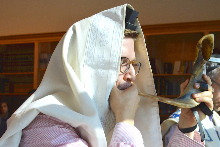 BLASTS:   Rabbi David Block blew the shofar after Shacharit in the main minyan Aug. 31. Rosh Hashanah starts Sunday evening, Sept. 9. Shana tova!  BP Photo by Alyssa Wallack.