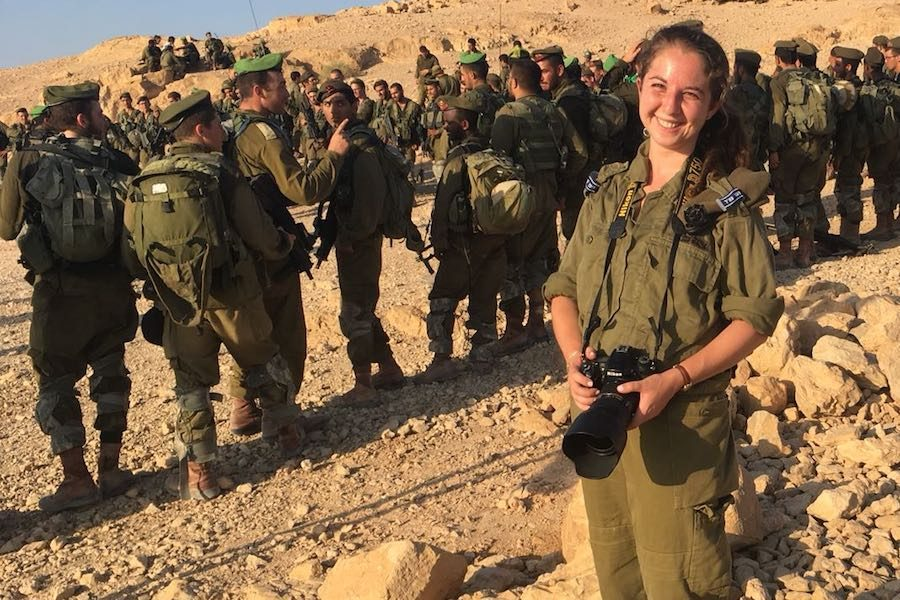 BERETS:   IDF Private Rachel Lester, Shalhevet class of 2012, posed with her camera at sunrise at the end of the Nahal Beret March last summer. The recruits later received their green berets.  Photo by Samantha Sharpe.