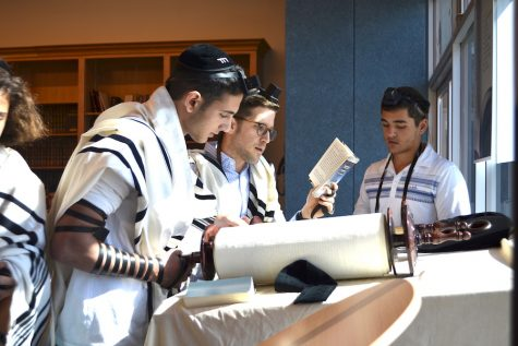 CHANT:   Senior Jeremy Ashagian chanted from the Torah scroll as Rabbi David Block followed along watching for errors. Many students know how to do this, and a few do it professionally on a regular basis at synagogues like B'nai David-Judea and Young Israel of North Beverly Hills.