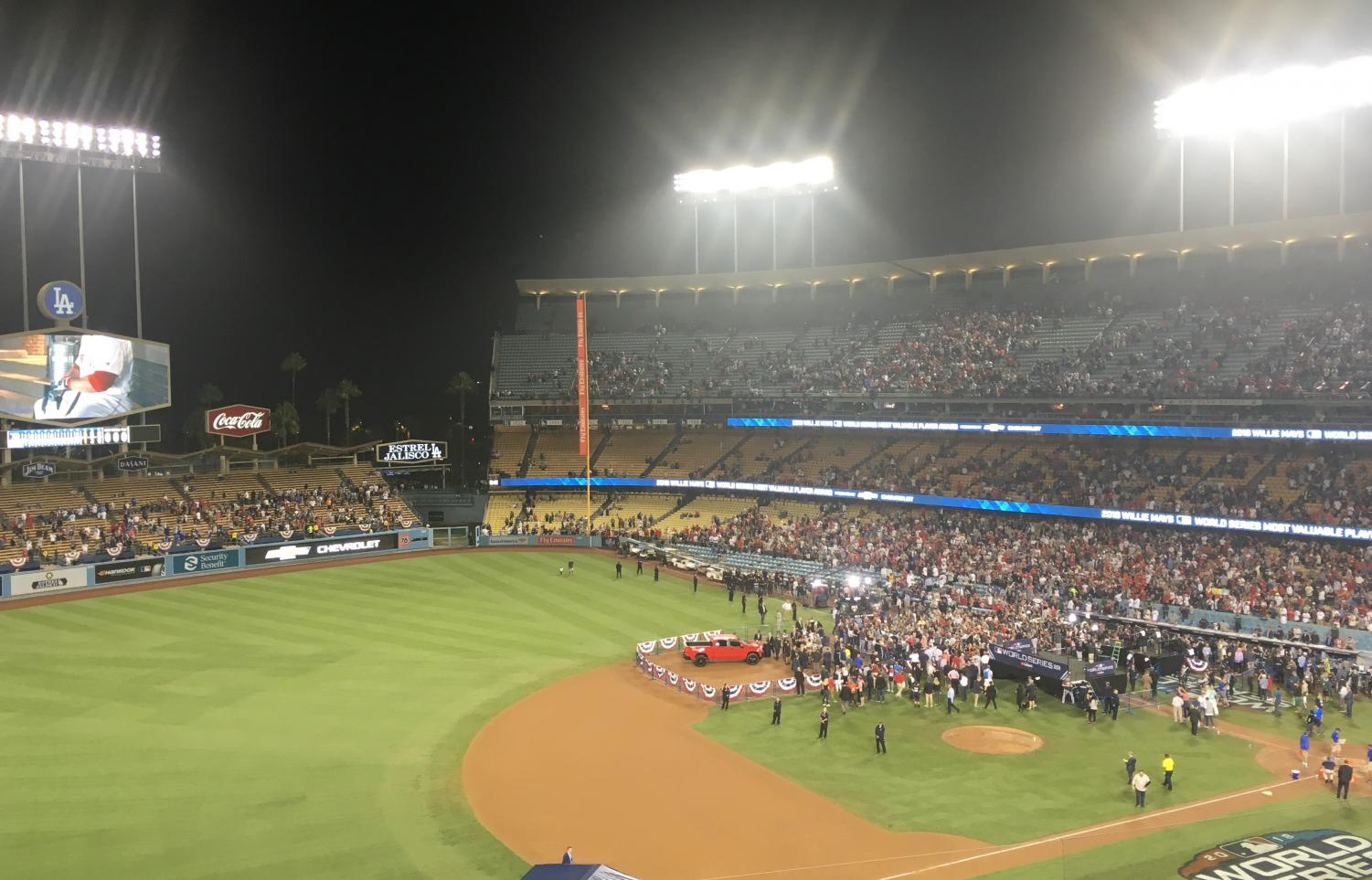 AFTERMATH:    Red Sox players meet the news media in Dodger Stadium after winning the World Series four games to one  Oct. 29.  The stands above them, which had been a sea of blue and white, had mostly emptied out -- except for Boston fans, dressed in red.