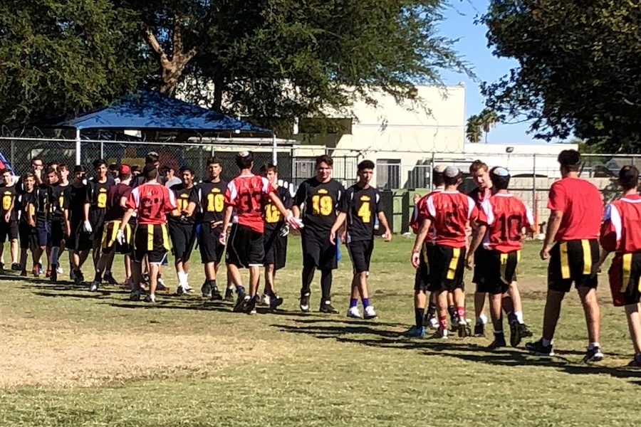 NEIGHBORS:   Firehawk and Panther flag football players, many of whom grew up together and attended the same elementary schools, congratulated one another after a contentious game Sept. 16 at Woodley Park in Van Nuys.