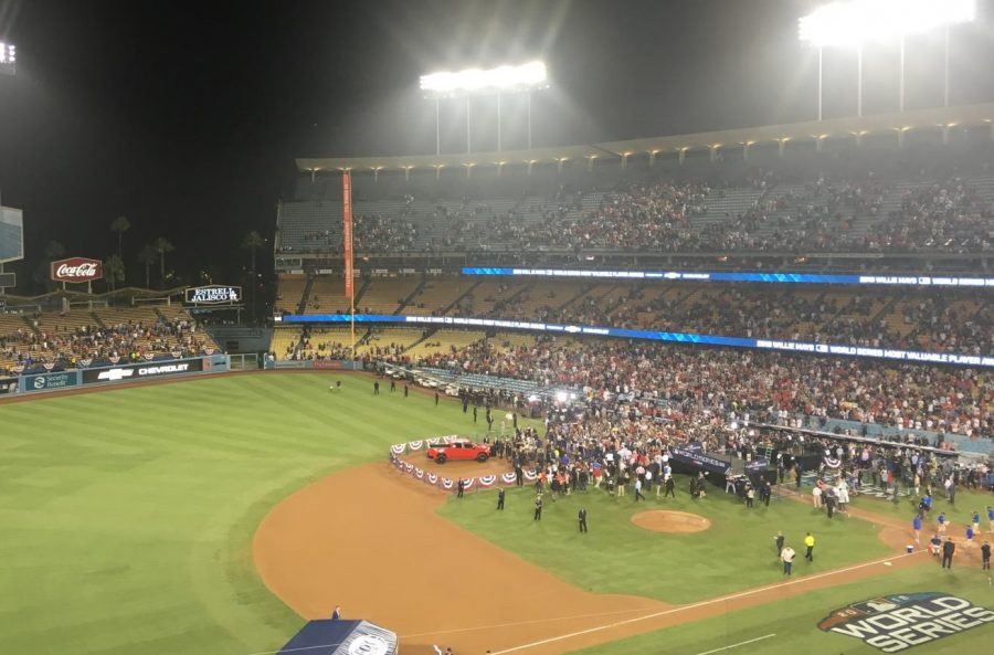 AFTERMATH: Red Sox players meet the news media after winning the World Series four games to one at Dodger Stadium Oct. 29.  The stands above them, which had been a sea of blue and white, had mostly emptied out.