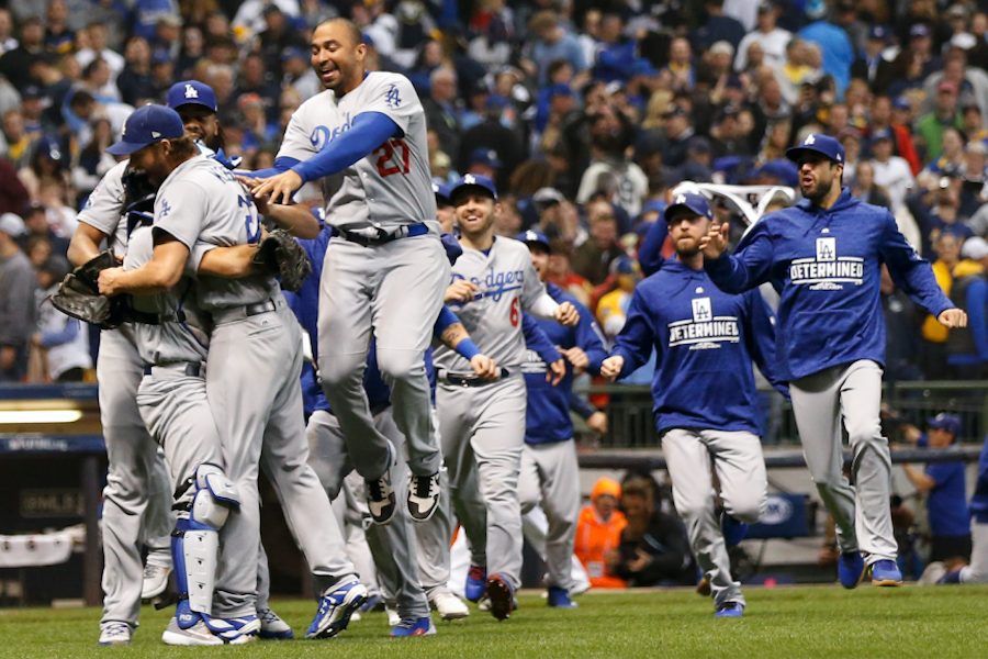 CELEBRATE:    Dodgers celebrated on the field in Milwaukee after their division-winning defeat of the Brewers Oct. 20.