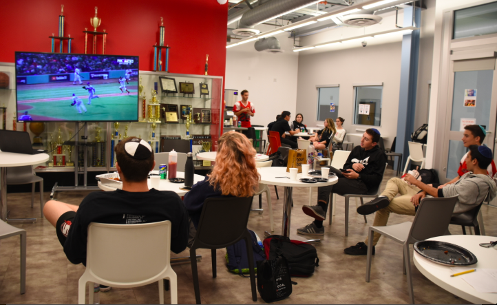 MIXED:   Dodger and Red Sox fans ate chicken wings and watched Game 2 of World Series together on Oct. 24 in the cafeteria.