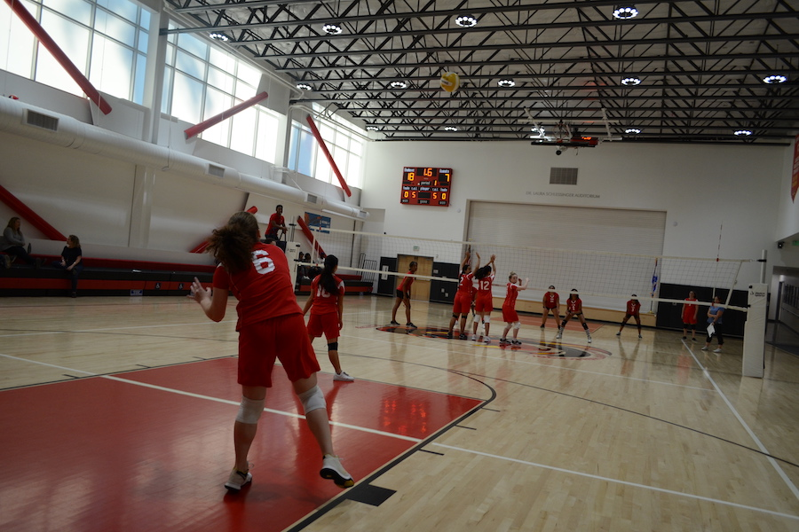 SERVE:    Freshman Jessica Melamed starts a play as her teammates get into position during the Firehawks' victory over Wish Charter in the gym Oct. 18.
