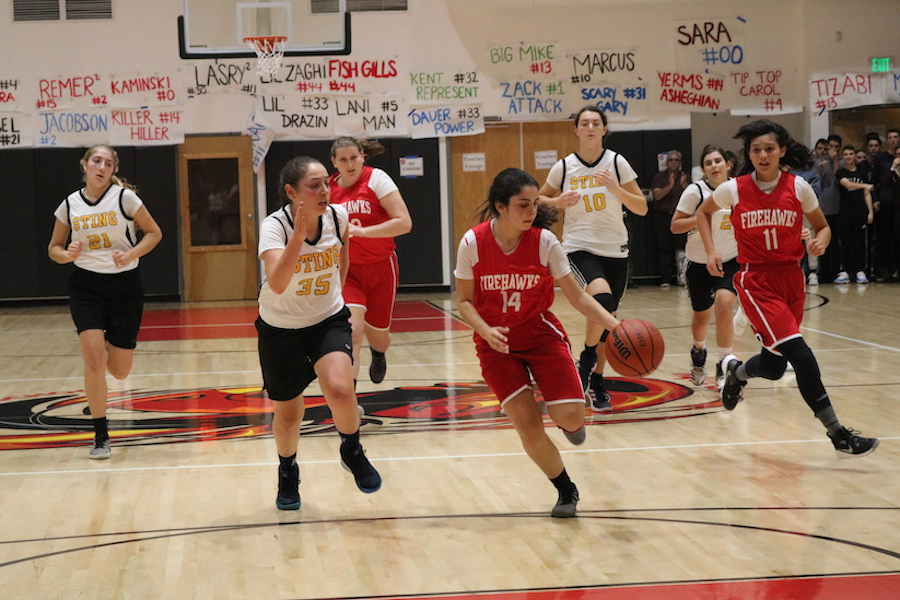 STAR:  Firehawk guard Maital Hiller steals the ball and drives towards the basket for a lay up. That game, the Firehawks lost to the SAR Sting—the eventual winners of the girls' tournament—by a score of 55-27.