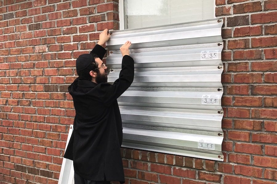 SAFE:  Rabbi Mendel Danow attached covered the windows of the Chabad Jewish Center Pensacola with metal siding to protect from the winds of Hurricane Michael.
