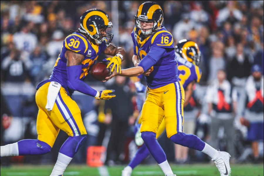 WINNERS:   LA Rams running back Todd Gurley receives a hand-off from quarterback Jared Goff in the team's 30 - 22 victory over the Cowboys Saturday night.