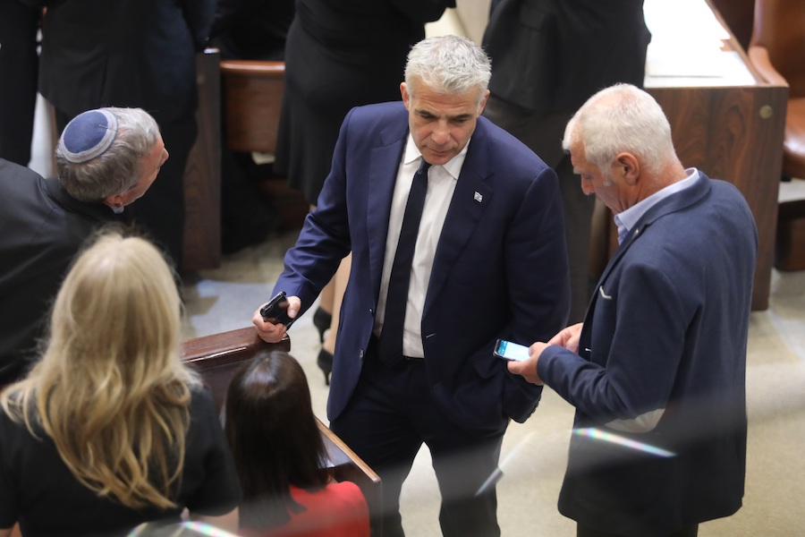 GOVERNING:   Israel's parliament meeting in the Knesset in December before it was adjourned until after new elections. At center is Yair Lapid, leader of the Yesh Atid party