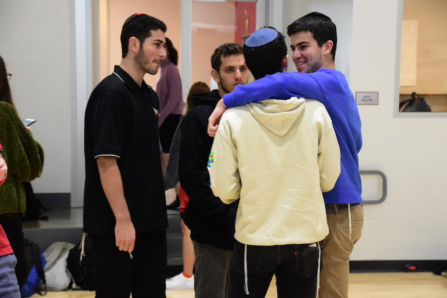 CHANGES:    Then-juniors Eitan Remer (third from left) and Jonathan Fishman (fourth from left) wrote a proposal last year that allowed boys to wear non-collared shirts provided they are wearing tzitzit that are visible. Rabbi Schwarzberg says boys have not been following this rule.