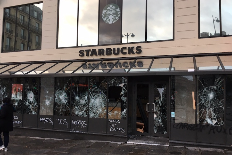 VIOLENCE:    A Starbucks outside the St. Lazare train station was vandalized and looted on Dec. 8, with inscriptions on the store saying 'Pay your taxes' and 'Return us the money'.