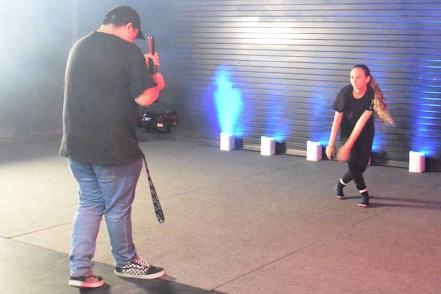 STARS: Junior Sheyna Schusterman danced her scene in the Wildfire Theater May 9 while being professionally videotaped, a first for Shalhevet dancers. The Dance Club's teacher is Erica Klein, famous for modern dance choreography on television and social media.