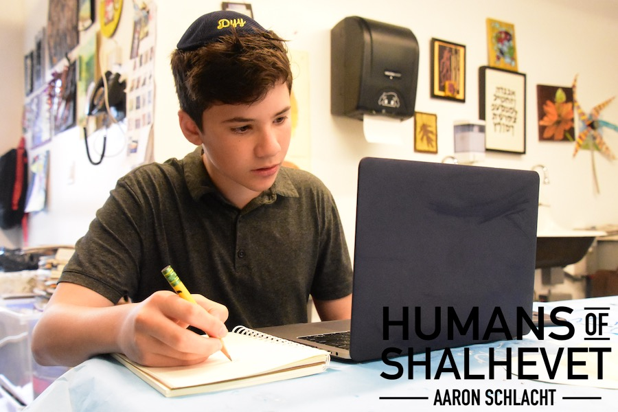 TRANSFER: Freshman Aaron Schlacht starts his animations by drawing characters on a piece of paper and then transferring the image to his computer. His computer allows him to edit the characters that he draws.