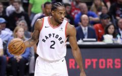 STAR: Toronto Raptors forward Kawhi Leonard gets ready to drive in the Raptors 118-109 victory over the reigning-champion Golden State Warriors on May 30. Leonard, the 2014 NBA Finals MVP with the San Antonio Spurs, played a team high 43 minutes and scored 23 points in the game.