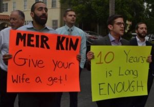 PROTEST: From left, Shalhevet faculty Rabbi Yitzchak Etshalom, Dr. Jonathan Ravanshenas, Mr. Chris St. Germaine, and Rabbi David Block stood outside a home on Poinsettia Place in Hancock Park to support Lonna Ralbag's right to a get, or religious Jewish divorce,  Aug. 23.Agunah activist Rabbi Jeremy Stern joined them, at right.