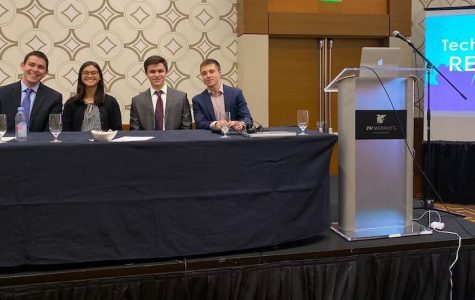 PRESENTERS:   From left, seniors Evan Rubel, Kiku Shaw, Sam Rubanowitz, and Gilad Spitzer sat onstage in front of over 120 people when they presented their projects from this summer.