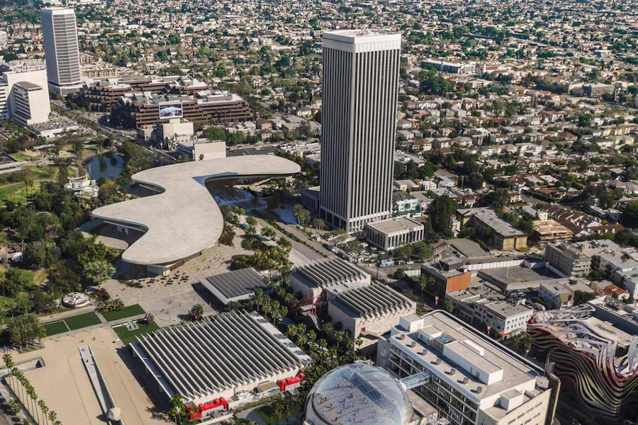 NEIGHBORHOOD:   The new LACMA building, as shown above in an architect's illustration, will be built near two other bold projects -- the Petersen Automotive Museum, seen at bottom right with its zig-zag curves, and the future Academy Museum of Motion Pictures with its giant domed sphere, designed by Renzo Piano and set to open next year two blocks north of school.  LACMA will retain its two newest buildings, located just next to the new Academy building. Fairfax Avenue is at the bottom of the picture.