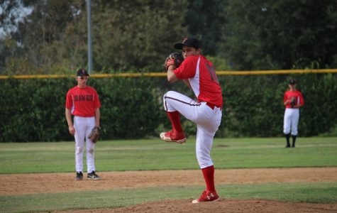 FOCUS: Senior Zach Helfand winds up to pitch during the Firehawks win over the East Valley Eagles Sept. 22. The Firehawks are participating in a fall ball program until Dec. 1 in preparation for the competitive season next spring..