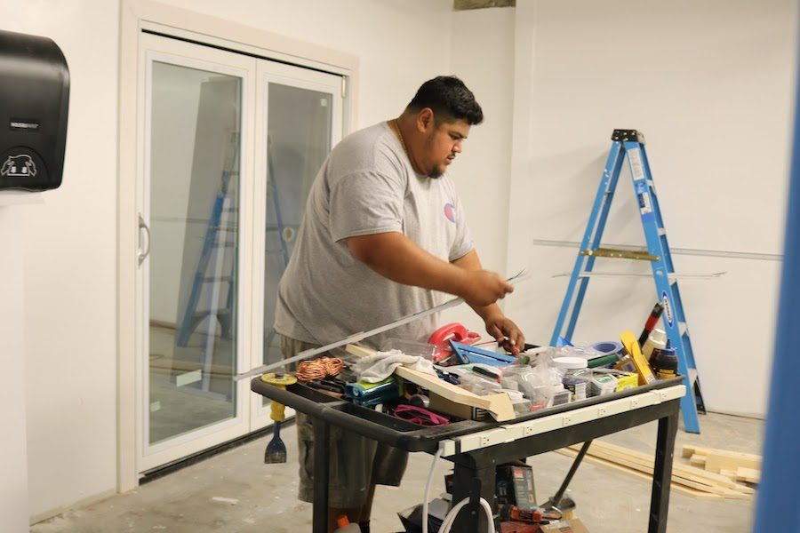 PROGRESS: Jose Flores Jr. worked last month on what will be Room B104, a new digital media center. When finished, there will be five basement classrooms in all.