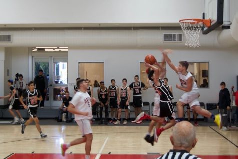 BOOM:   Sophomore Joel Asheghian attempts a lay-up in the Firehawks 53-35 win over the HAFTR Hawks Nov 7. The Firehawks boys are set to play the SAR Sting at 1:30 p.m today after the girls play the YULA Panthers at noon.