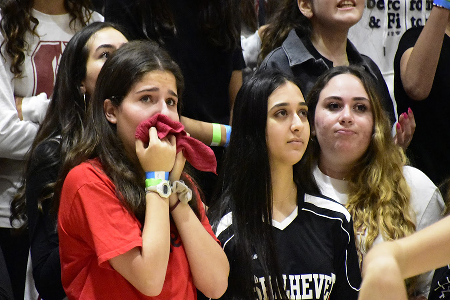 EMOTIONAL:  From left, seniors Nicole Klausner, Eliana Mizrahi and Shayna Becker were among Firehawk fans worrying in the final moments of Shalhevet girls' 65-61 semi-final loss to the SAR Sting in the Glouberman Tournament Nov. 9. The Firehawks led by as many as 16 points before halftime but were unable to eke out a win in a nail-biting repeat of last year's tournament. The Maimonides MCATS won the girls' tournament, and the Frisch Cougars beat the Firehawk boys to win the boys'.